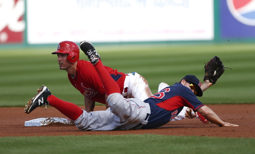 St. Louis Cardinals'  Randal Grichuk (15) is tagged out by Boston Red Sox second baseman Brock Holt (26) after being caught off base in the second inning of an exhibition spring training baseball game  Monday, March 9, 2015, in Jupiter,  Fla. (AP Photo/John Bazemore)