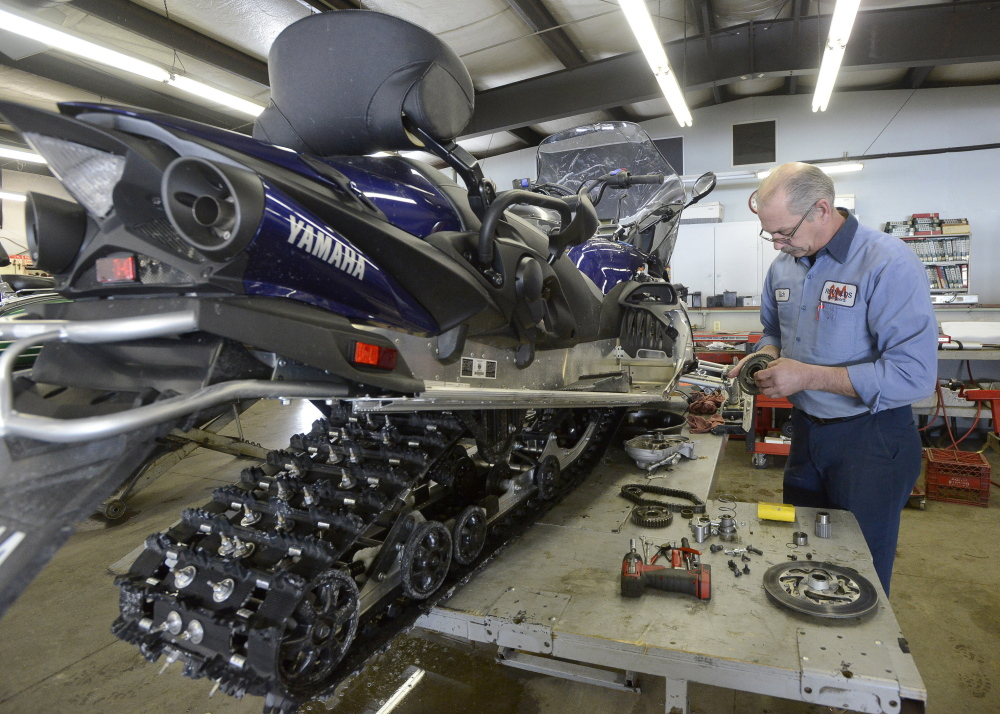 """Richard Diekema works on a snowmobile at Reynolds Motorsports in Buxton in March of 2015. The company said on its Facebook page, """"Rich Diekema was more than a co-worker. He was a great friend to many and will be missed by everyone who knew him.""""  File photo/John Patriquin"""
