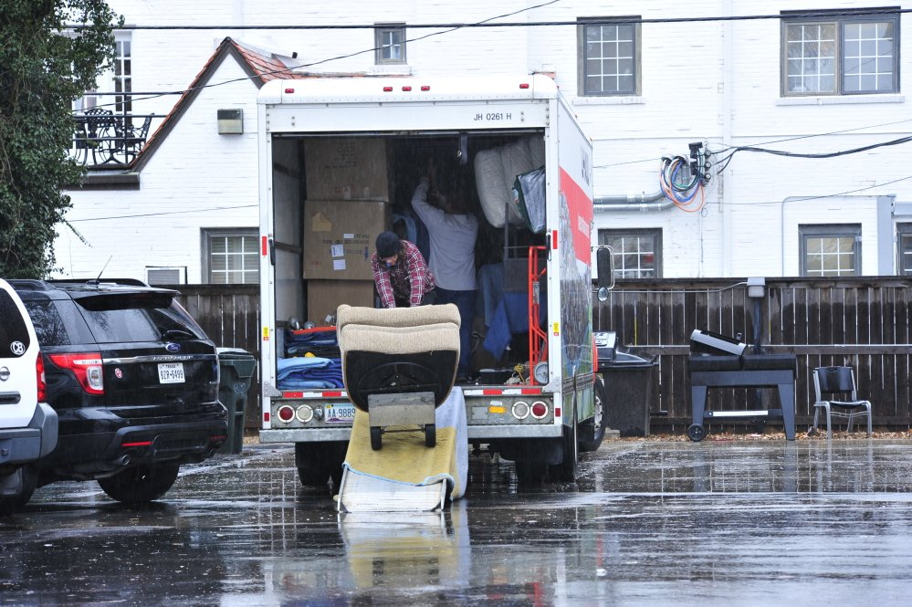 Students at the Sigma Alpha Epsilon house load up a moving truck with their belongings at the University of Oklahoma on Monday in Norman, Okla.