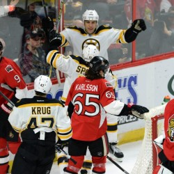 Ottawa Senators, left to right, Milan Michalek, Erik Karlsson and Craig Anderson react to a goal by the Bruins' Ryan Spooner, center, as he celebrates with teammate Milan Lucic during the second period Tuesday night in Ottawa, Ontario.