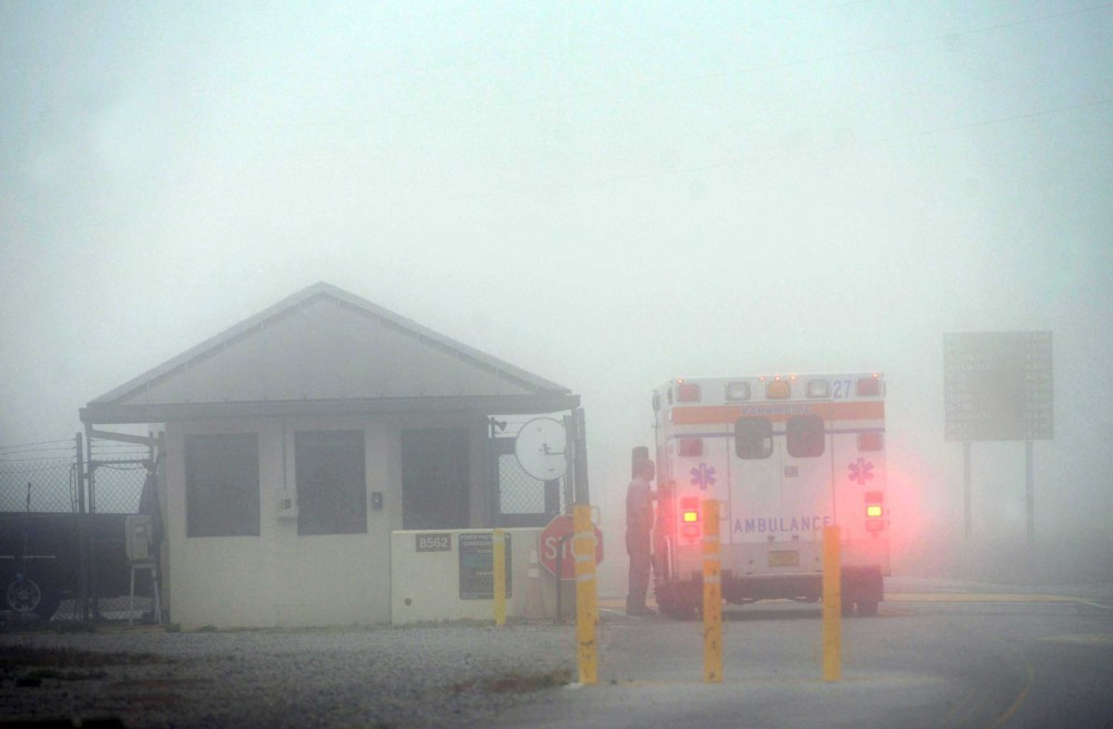 An Okaloosa County ambulance sits at the Eglin Air Force entrance in Fort Walton Beach, Fla., Wednesday.