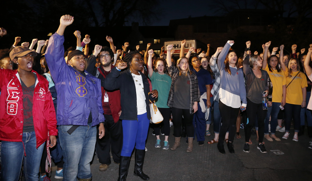 University of Oklahoma students rally outside the now closed University of Oklahoma's Sigma Alpha Epsilon fraternity house during a rally in Norman, Okla., Tuesday.