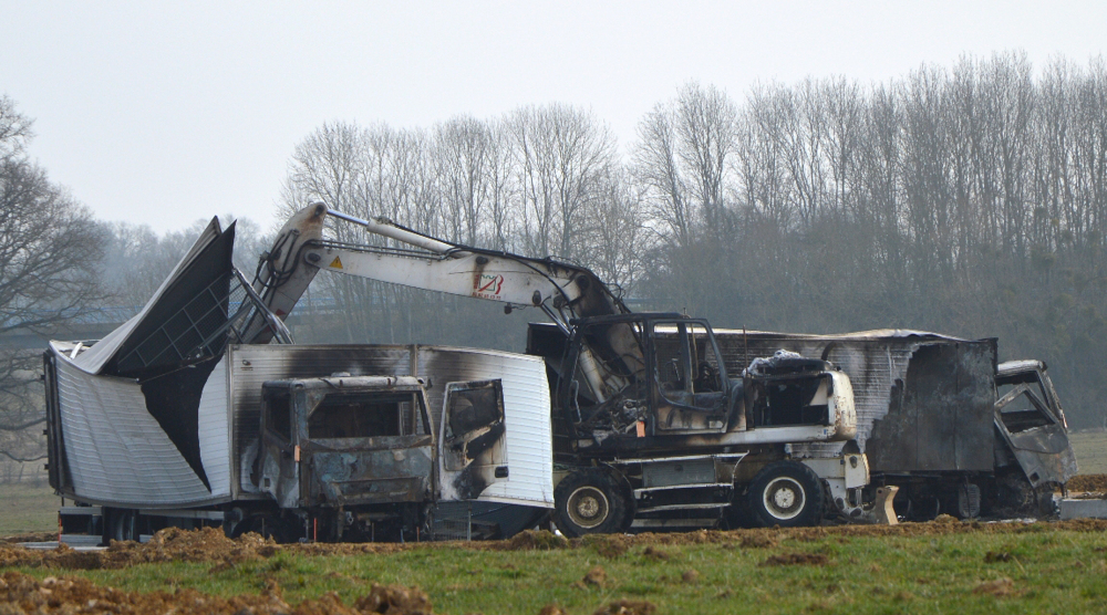 A police official says that 15 armed assailants attacked two vans carrying jewels worth millions on a French highway and sped away. The vans were found burned.