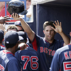 Garin Cecchini of the Boston Red Sox is welcomed back to the dugout after scoring on Travis Shaw's two-run double in the fourth inning of a 10-6 victory against the New York Yankees at Tampa, Fla. Alex Rodriguez hit a home run for the Yankees in the game.