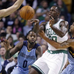 Boston Celtics forward Brandon Bass passes the ball under pressure from Memphis Grizzlies guard Courtney Lee, right, forward JaMychal Green (0) and center Marc Gasol during the first half of Wednesday night's game in Boston. The Celtics won, 95-92, in a game that was close all the way.