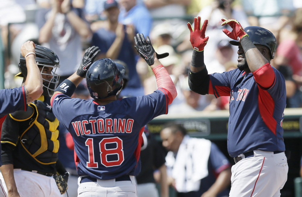 Red Sox designated hitter David Ortiz, right, is congratulated by Shane Victorino after hitting a three-run homer in the third inning of a spring training victory over the Pirates on Thursday.