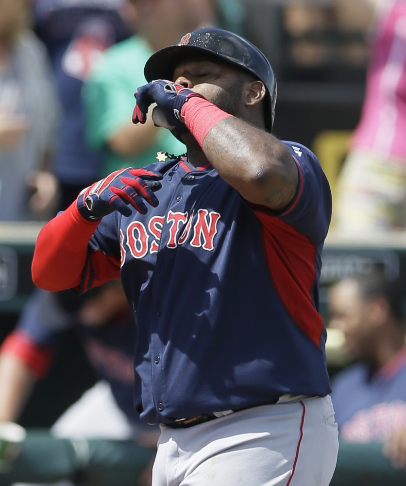 Pablo Sandoval looks skyward after hitting his first home run for the Red Sox, a solo shot in the third that put Boston ahead 4-1 during Thursday's win over Pittsburgh.
