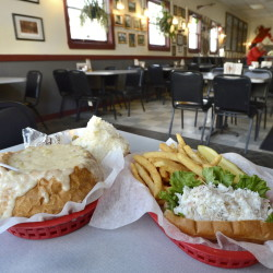 Clam chowder in a bread bowl and a crab meat roll with fries at Gilbert's Chowder House.