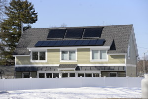 A home with solar panels on Victor Road in Portland. A recently released study by the state shows investment in solar power offers long-term benefits for consumers and the environment. The report will form the basis for debate in Augusta around the cost-effectiveness of subsidies. Shawn Patrick Ouellette/Staff Photographer