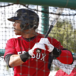 Boston Red Sox' Yoan Moncada bats during practice at spring training baseball Friday in Fort Myers Fla. The Red Sox finalized a minor league contract with the 19-year-old Cuban infielder that includes a $31.5 million signing bonus, easily a record for an international amateur free agent under 23 years old. The Associated Press