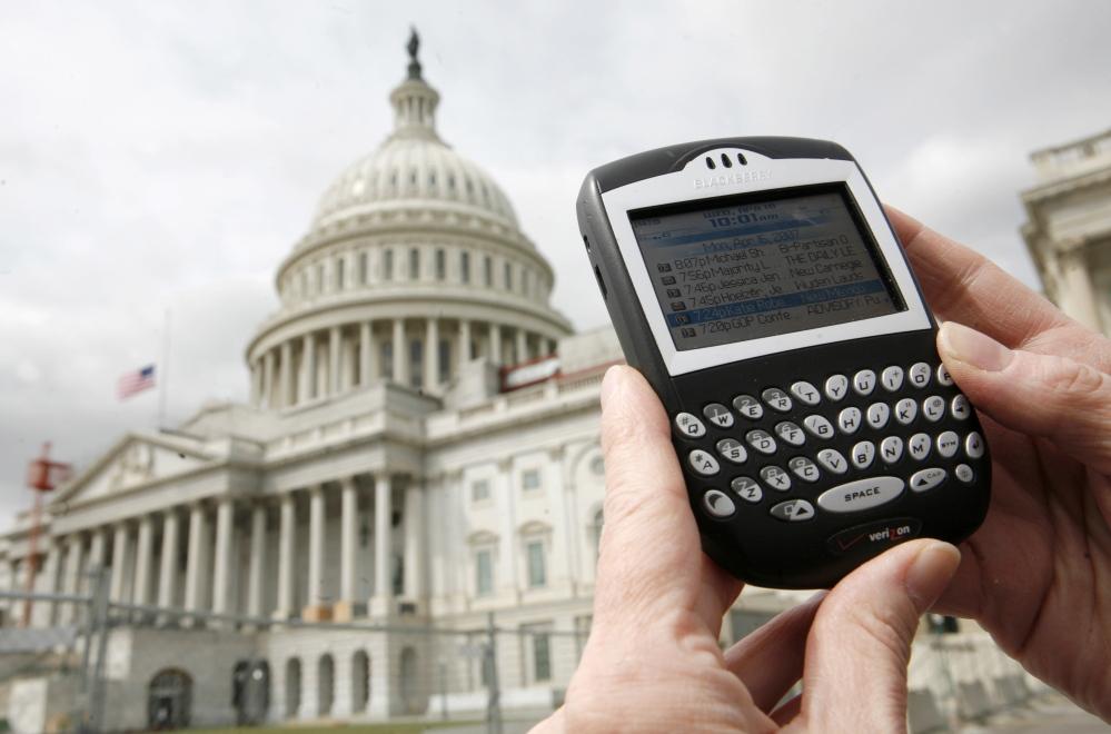 Hillary Clinton's BlackBerry was used for both her official work and for her yoga routines. The government has no uniform technology policy for its 2.7 million workers.