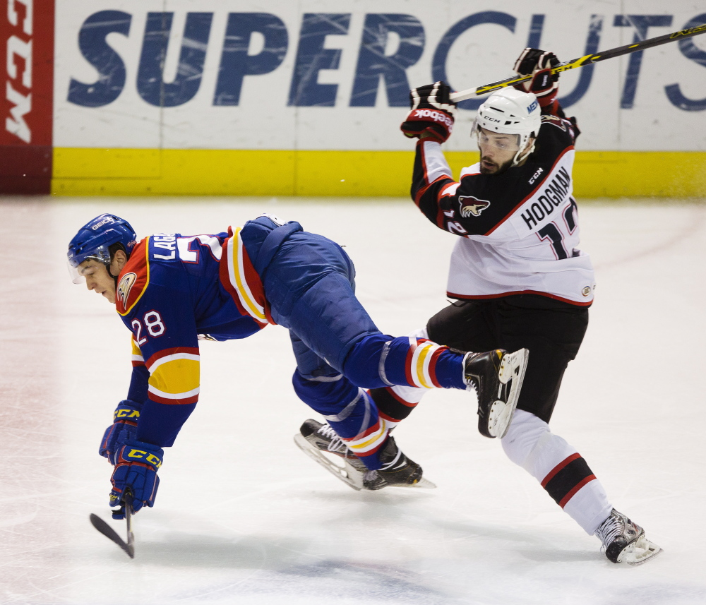 Norfolk Admirals center Antoine Laganiere heads for the ice as his skate gets tied up with Portland's Justin Hodgman during the Pirates' 2-1 win at home on Friday. A goal by Portland defenseman Dylan Reese gave the Pirates their sixth straight win. Carl D. Walsh/Staff Photographer