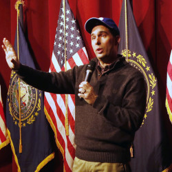 Wisconsin Gov. Scott Walker speaks at a training workshop for the New Hampshire state Republican Party in the auditorium at Concord High School on Saturday.