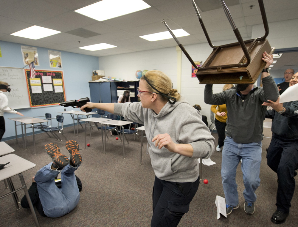 Fighting back is one technique being taught. Officer Shari Lanaman played the intruder and was just about to find out what fighting back meant when the exercise was halted. Tribune News Service