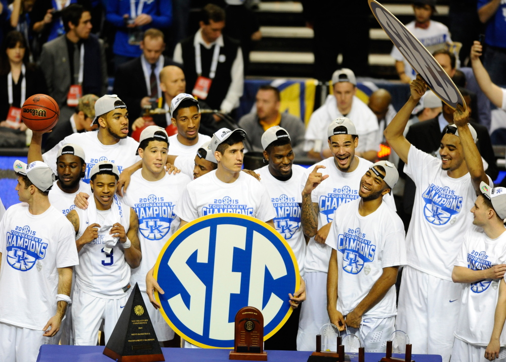 The Kentucky Wildcats celebrate after winning the SEC tournament championship on Sunday. The Wildcats are 34-0 and earned the top seed in the NCAA Division I men's basketball tournament.