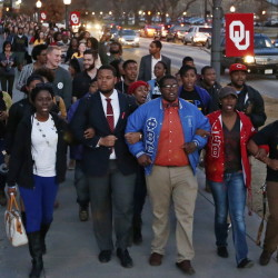 University of Oklahoma students march to the now-closed Sigma Alpha Epsilon fraternity house Tuesday after members of the fraternity were caught on video chanting a racial slur.