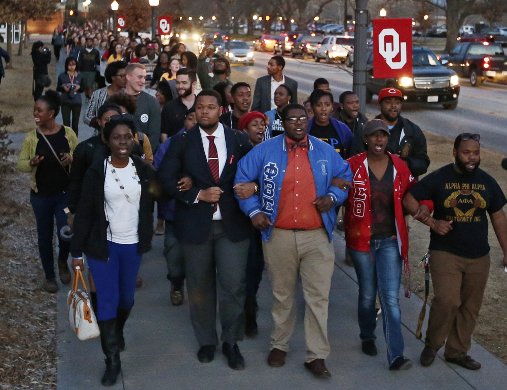 University of Oklahoma students march to the now closed University of Oklahoma's Sigma Alpha Epsilon fraternity house during a rally this month in reaction to an incident in which members of a fraternity were caught on video chanting a racial slur, in Norman, Okla.