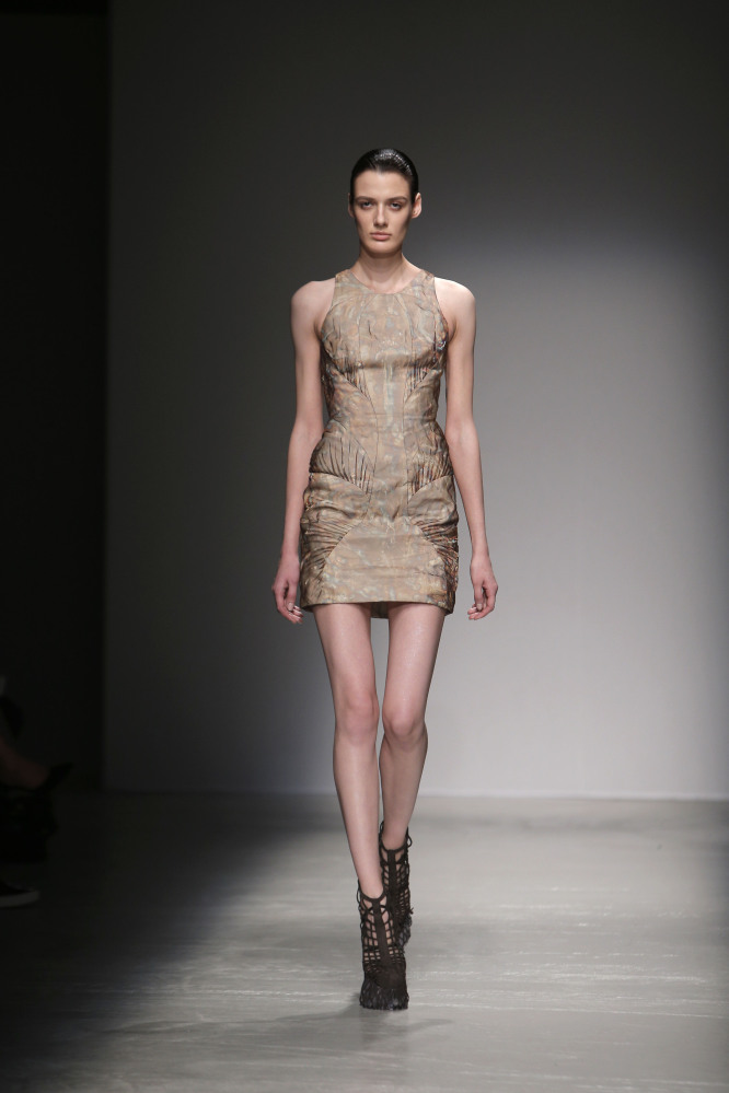 A model wears a creation for Iris van Herpen's ready to wear fall-winter 2015-16 fashion collection this month in Paris. France's health minister supports plans to criminalize the use of advertising with anorexic models in France.