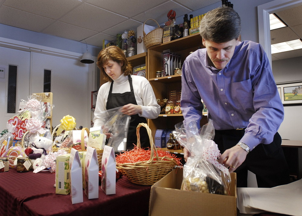 Margo and Marc Badeau, seen working at their Gorham business in 2007, are now identified in court records as the targets of an investigation by multiple federal agencies. Press Herald file photo/Jack Milton