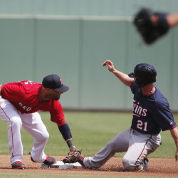 Minnesota's Shane Robinson steals second as Boston's Dustin Pedroia is late with the tag in the first inning Wednesday in a spring training game at Fort Myers, Fla. The Red Sox beat Minnesota's split-squad team, 3-2.