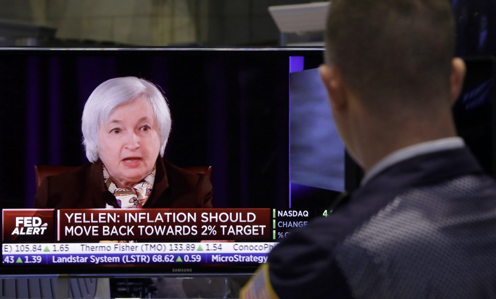 A trader on the floor of the New York Stock Exchange watches Federal Reserve Chair Janet Yellen's news conference Wednesday.