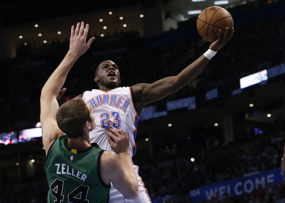 Oklahoma City Thunder guard Dion Waiters shoots as Celtics center Tyler Zeller defends in the first quarter of Wednesday night's game in Oklahoma City. The Thunder snapped Boston's five-game winning streak.