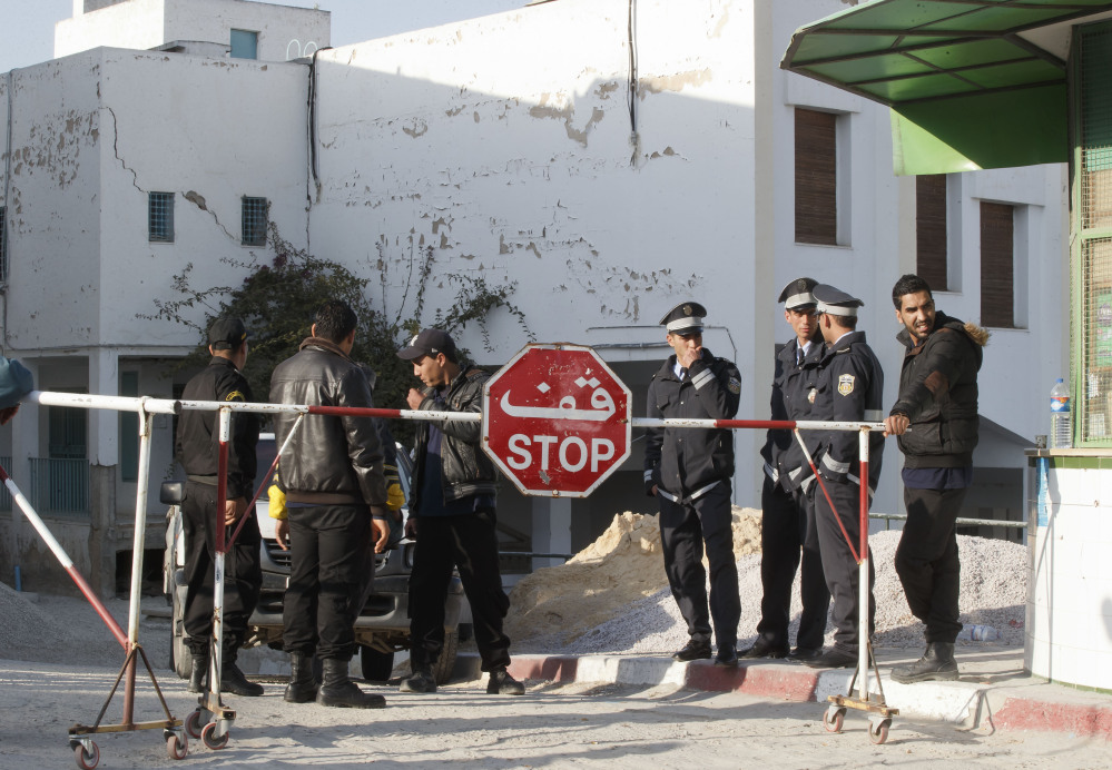 Tunisian police officers guard the entrance of the morgue of the Charles Nicolle hospital in Tunis on Thursday. The Islamic State Group claimed responsibility Thursday for the attack on a famed Tunis museum that left 23 people dead.