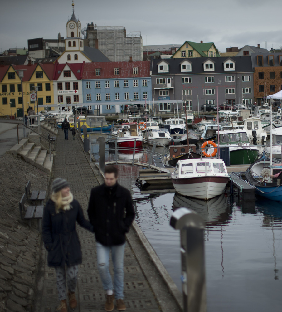Boats lie in the harbor in Torshavn, the capital city of the Faeroe Islands. The Faeroe Islands, a semi-autonomous Danish archipelago, and Svalbard, a Norwegian archipelago in the Arctic Ocean, are the only two places in the world where a total solar eclipse can be viewed Friday. The Associated Press