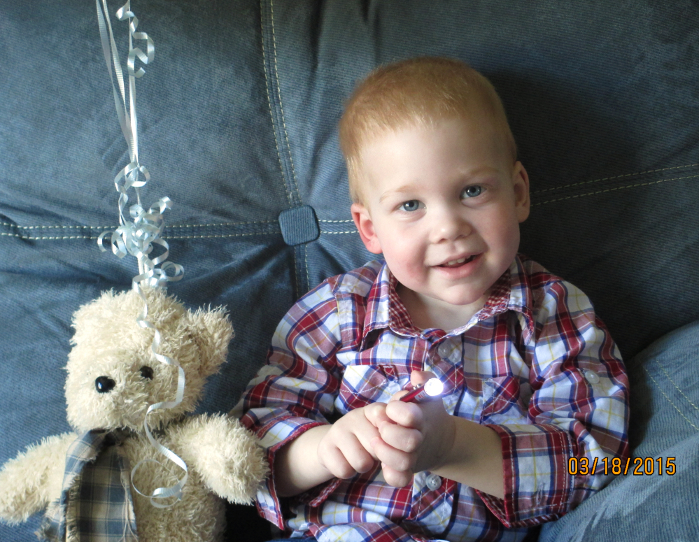 Gardell Martin, 22 months old, sits with his teddy bear in his home in Mifflinburg, Pa., on Wednesday. Gardell's body temperature was 20 degrees below normal and he had no pulse when he was pulled from an icy creek. But he revived after an hour and 41 minutes of CPR and the warming of his body and has suffered virtually no lingering effects.