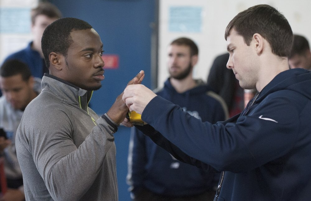 Damarr Aultman has his hand measured by Brandon Yeargan  before tests begin at Thursday's Pro Day. Though not tall by reciever standards, Aultman can make up for it with terrific leaping ability.