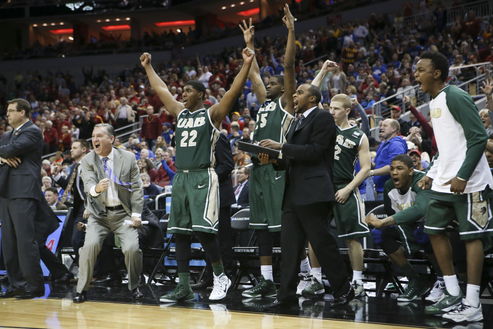 The University of Alabama at Birmingham bench cheers after guard Robert Brown hit a 3-point basket in the closing seconds of the second half against Iowa State in the second round of the NCAA college basketball tournament in Louisville, Ky., on Thursday. UAB won the game 60-59.