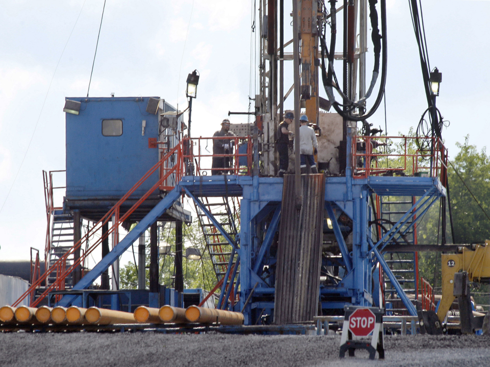 A crew works on a gas drilling rig at a well site for shale based natural gas in Zelienople, Pa. The Obama administration is requiring companies that drill for oil and natural gas on federal lands to disclose chemicals used in hydraulic fracturing operations.