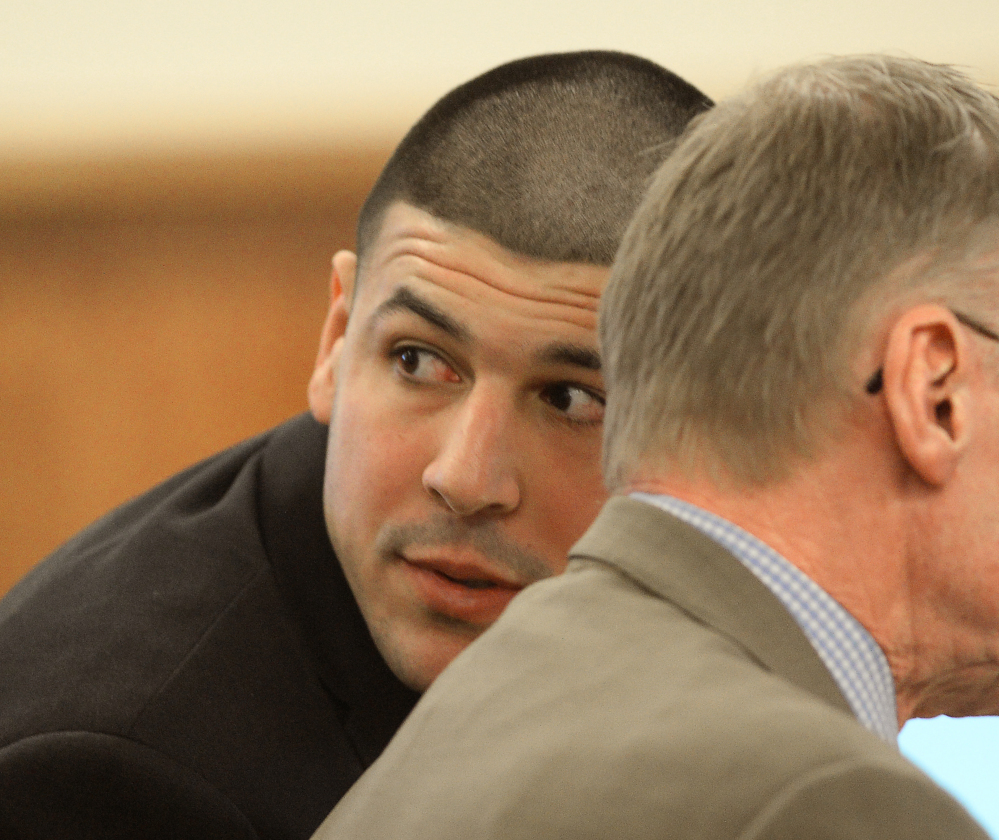 Aaron Hernandez looks toward the gallery during testimony Friday in Fall River, Mass.