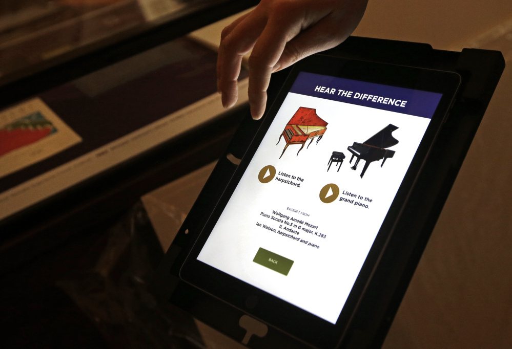 An interactive audio tablet is set up at the exhibit, which is aimed at making classical and Baroque music cool for the iTunes generation and beyond.