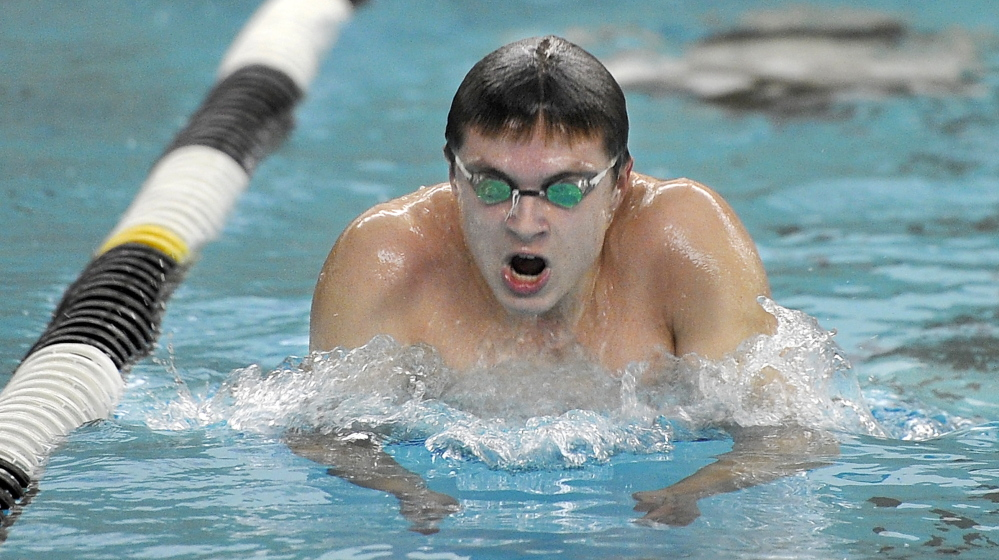 "Nate Samson, a junior at Brunswick, works on his breast stroke at Bowdoin's Leroy Greason Pool. Says Samson: ""I like going fast. The practices, they get boring going back and forth, but I love the feeling of racing."""