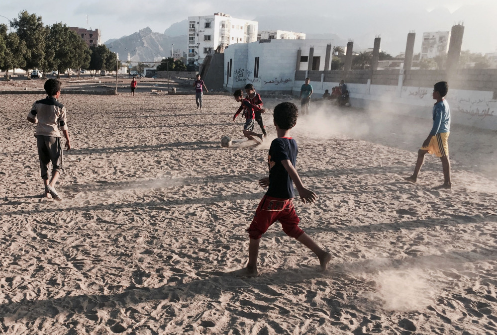 In this photo taken Saturday, children play soccer in an open field in Aden, Yemen. The city is visibly expecting assault, whether from the forces of Hadi's rival, ousted President Ali Abdullah Saleh, who has allied himself with the Shite rebels, or from al-Qaida militants.