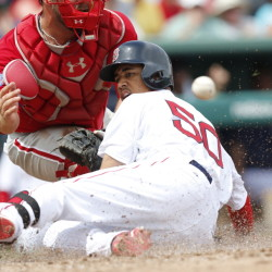 Boston's Mookie Betts slides home with an inside-the-park homer, just ahead of the throw to Philadelphia Phillies' catcher Cameron Rupp in the third inning of Sunday's spring training game in Fort Myers, Fla.