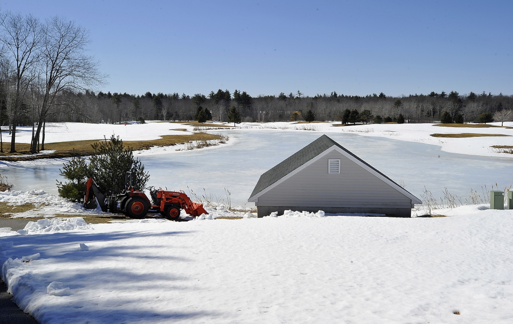 The ponds are still frozen and the course is covered with snow as spring approaches at the Nonesuch River Golf Club, usually one of the first Maine courses to open for the season. Gordon Chibroski/Staff Photographer