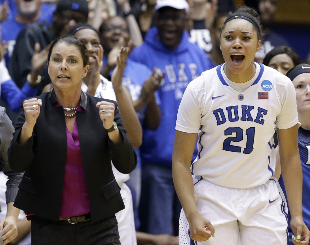 Duke Coach Joanne P. McCallie and Kendall Cooper celebrate Sunday near the end of the Blue Devils' 64-56 victory over Mississippi State in Durham, N.C. on March 22, 2015.