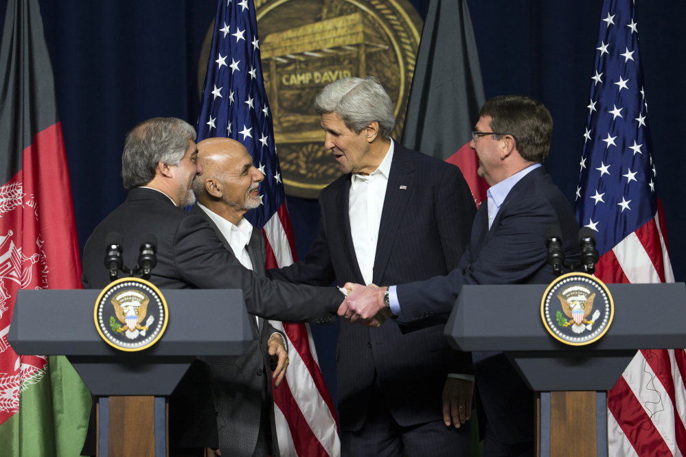 From left, Afghan chief executive Abdullah Abdullah, Afghan President Asraf Ghani, Secretary of State John Kerry and Secretary of Defense Ash Carter shake hands after a news conference at Camp David on Monday. The pace of U.S. troop withdrawals from Afghanistan will headline Ghani's visit to Washington, yet America's exit from the war remains linked to the abilities of Afghan forces.