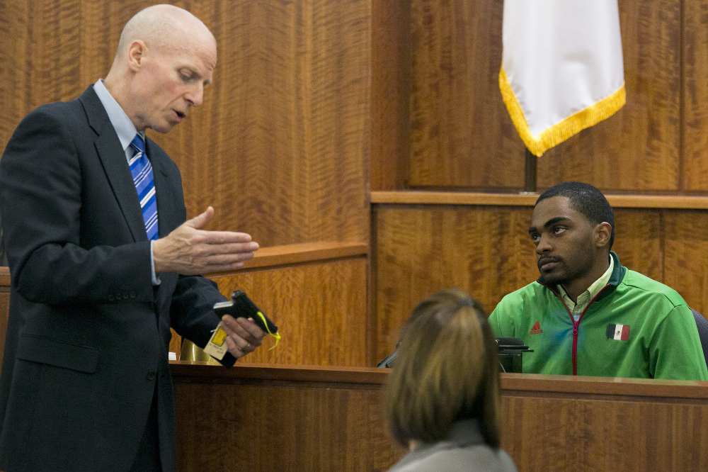 Prosecutor William McCauley questions Gion Jackson, who purchased the pistol recovered near the crime scene, during the murder trial of former NFL football player Aaron Hernandez in Bristol County Superior Court on Monday in Fall River, Mass.
