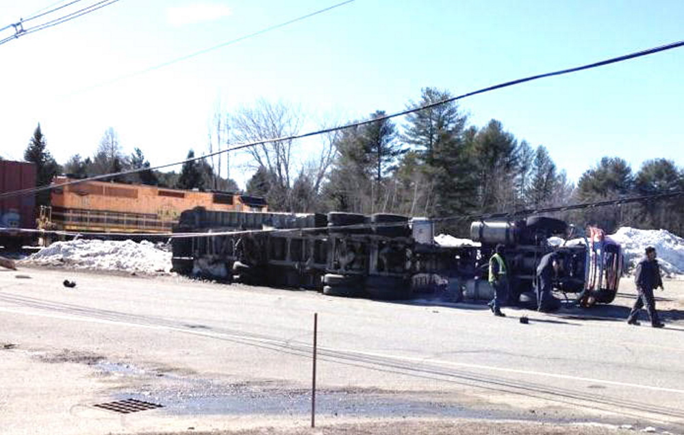A train and tractor-trailer collided on Hotel Road in Auburn on Monday.