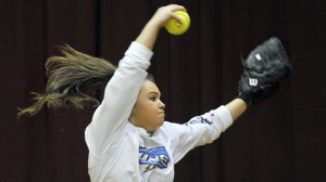 Bailey Tremblay, a Thornton Academy senior, winds up for a pitch on the first day of practice for Maine high school pitchers and catchers. Tremblay led the Golden Trojans to their first Western Class A championship last year and is regarded as one of the state's top softball pitchers.