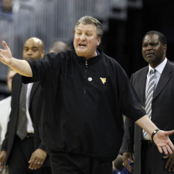 West Virginia Coach Bob Huggins says his team will be up to the challenge for Thursday night's Sweet 16 game against unbeaten Kentucky, the NCAA tourney's top overall seed.
