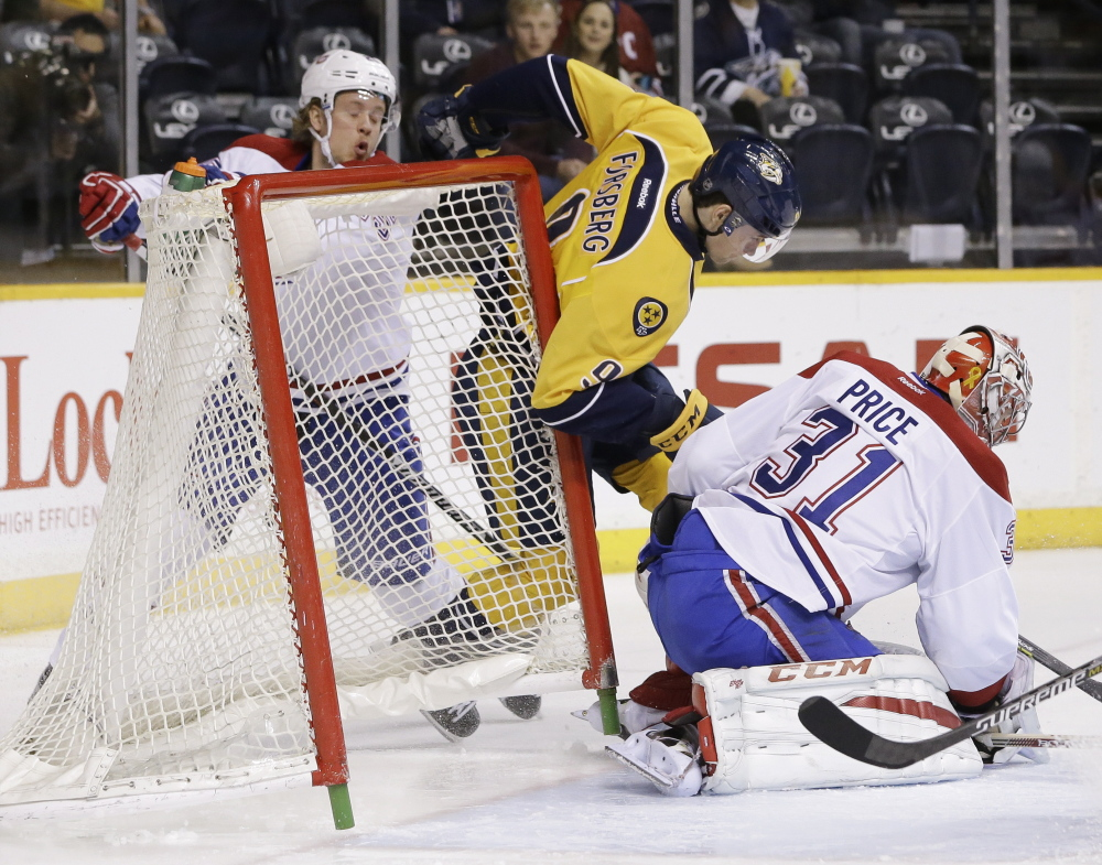 Nashville's Filip Forsberg knocks the net loose as he collides with Montreal's Jacob De La Rose as goalie Carey Price covers the puck in Tuesday's game at Nashville, Tenn.