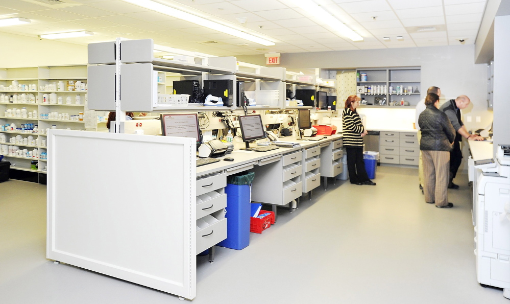 Among Maine industries with higher growth in earnings is health care, which includes Maine Medical Center's 24-hour pharmacy and lab where prescriptions are filled by trained employees as well as a state-of-the-art robot.
