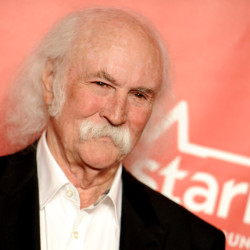 The Associated Press David Crosby, shown at a Feb. 5 event in Los Angeles, hit and injured a jogger with his car in Southern California. The California Highway Patrol said in a statement that Crosby was driving his Tesla electric car Sunday, at around 55 mph, the posted speed limit on the road in the Santa Barbara area where Crosby lives. The Rock and Roll Hall of Famer showed panicked and concern for the jogger during 911 calls.