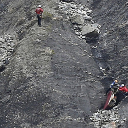 Rescue workers work on debris at the plane crash site near Seyne-les-Alpes, France, on Wednesday, where a Germanwings jetliner crashed Tuesday in the French Alps.
