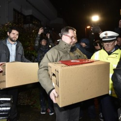 "Investigators carry boxes from the apartment of Germanwings co-pilot Andreas Lubitz on Thursday in Duesseldorf, Germany. French prosecutors said Lubitz ""intentionally"" crashed Flight 9525 into the side of a mountain Tuesday in the French Alps."