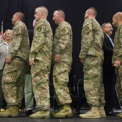 LEWISTON, ME - AUGUST 17: Members of Maine's 133rd Engineer Battalion, recently back from deployment in Afghanastan, are honored during a ceremony at the Colisee in Lewiston on Suday, August 17, 2014. (Photo by Carl D. Walsh/Staff Photographer
